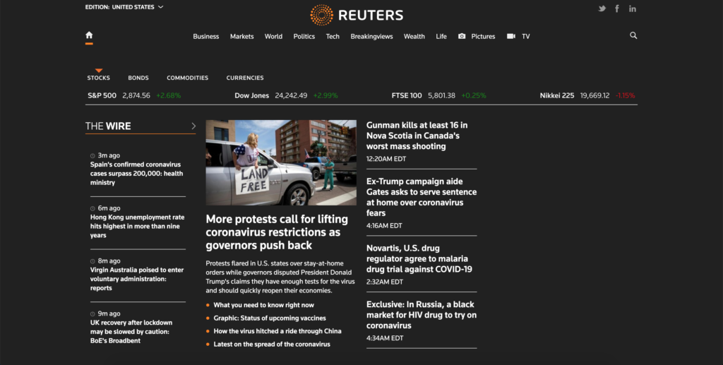 Reuters Night Mode enable with the free Turn Off the Lights browser extension